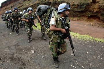 U.N. peacekeepers from Uruguay hike to higher ground near Kibati