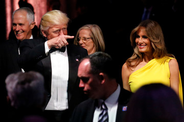 Donald and Melania Trump arrive with Malcolm and Lucy Turnbull at an event commemorating the 75th anniversary of the Battle of the Coral Sea, aboard the USS Intrepid Sea, Air and Space Museum in New York