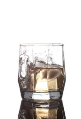glass with ice and whisky isolated on white background