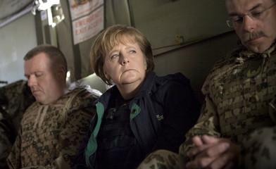 German Chancellor Angela Merkel sits with officers of the German army Bundeswehr in a helicopter as she flies from Kunduz to Mazar-i-Sharif