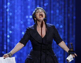 Patti LuPone accepts the award for Best Performance by a Leading Actress in a Musical for Gypsy at the 62nd Annual Tony Awards in New York