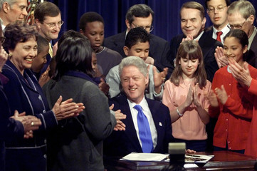CLINTON IS APPLAUDED AFTER SIGNING HIS LAST BUDGET LEGISLATION.