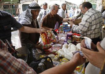Palestinians shop in a market in Hebron