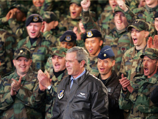 US President Bush is cheered on after addressing nearly 5000 military servicemen at Osan Air Base in South Korea