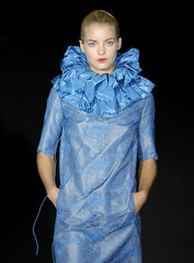 Model displays an outfit created by Carmen March during Pasarela Cibeles fashion week in Madrid