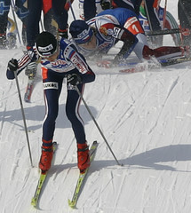 Russia's Tchepalova leads the pack of athletes while Czech Republic's Neumannova falls down in ...