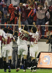 Sevillas Puerta and Maresca celebrate goal against Schalke 04 during UEFA Cup semi final soccer match in Seville