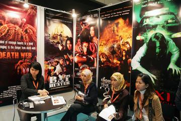 Malaysian visitors watch trailers of Thai movies at Hong Kong FILMART in Hong Kong