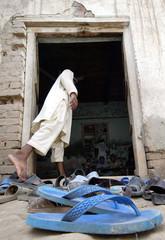 A Pakistani student enters madrasa Jamia-e-Taleem ul Koran of Qari Fateh Mohammad in village ...