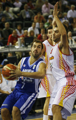 Greece's Spanoulis drives the ball past Spain's Calderon during second round game at the European Basketball Championships in Madrid