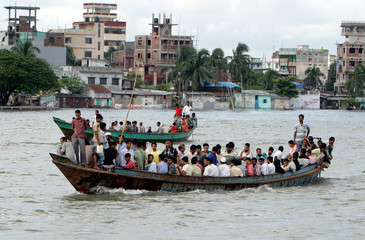 Crowded boats travel on the flooded bank of the river Buriganga.