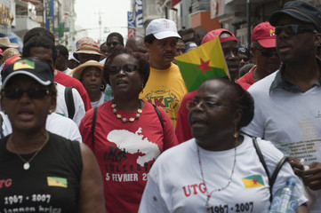 LKP union leader Domota walks with protestors during a demonstration in Pointe-a-Pitre, a day after France's President Sarkozy's visit to Guadeloupe
