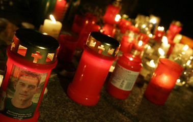 Candles are placed at Nikolai church during a solemn vigil for two German hostages in Leipzig