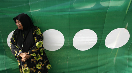 PAS supporter waits outside polling station in Bukit Gantang