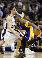 Lakers guard Bryant runs into Spurs guard Ginobili during first half of game in San Antonio, Texas