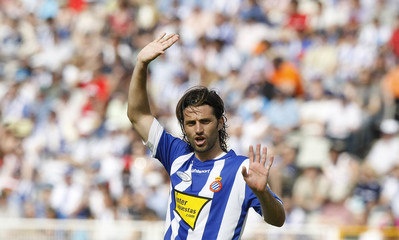 Espanyol's Jarque gestures during their Spanish first division soccer league match against Malaga at Lluis Companys stadium in Barcelona