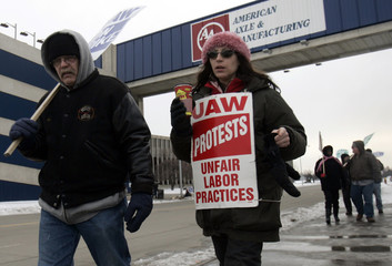 United Auto Workers union striking workers Gardner and Cybak picket outside the American Axel plant in Hamtramck