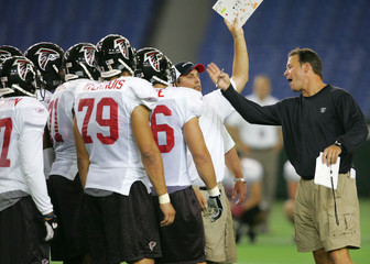 Atlanta Falcons head coach Mora shouts at his players during preparation for NFL pre-season match in Tokyo.