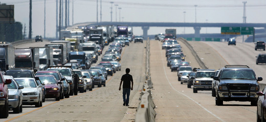 Man walks on highway as thousands of cars try to evacuate in advance of Hurricane Rita in north Houston