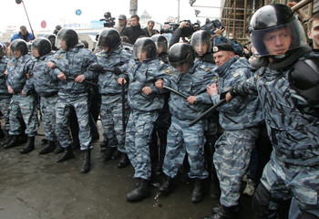 Russian police form a line as they prepare to block the march of opposition protesters in central Moscow