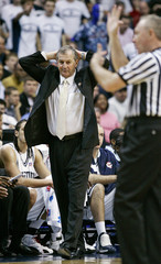 University of Connecticut coach Calhoun watches referee during men's NCAA basketball regional final against George Mason University in Washington