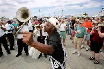 A member of the Young Olympia Aide and New Look Social Aid and Pleasure Club dances at the New Orleans Jazz and Heritage Festival