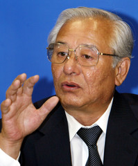 Nippon Telegraph and Telephone Corp (NTT) President Norio Wada listens to a reporter's question duri..