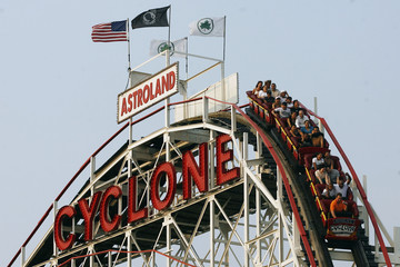 Visitors ride the Cyclone roller coaster at the Astroland Amusement Park in New York