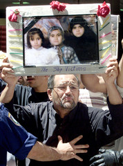 THE IRAQI FATHER OF THREE DEAD ASYLUM SEEKERS PROTESTS IN SYDNEY.