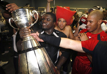 Stampeders' Labinjo celebrates with Grey Cup after defeating Alouettes in the CFL's 96th Grey Cup football game in Montreal