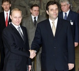 VLADIMIR PUTIN SHAKES HANDS WITH VOJISLAV KOSTUNICA IN BELGRADE.