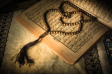 prayer beads on Koran ( holy book of Muslims )