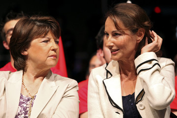 France's Socialist Party leader Aubry and Royal, French Socialist party member and Poitou-Charentes regional President talk before a political rally in Reze near Nantes