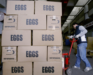 WORKER UNLOADS BOXES OF EGGS AT WHOLESALE MARKET IN HONG KONG.