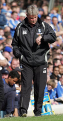 Birmingham City's manager Bruce looks at watch on touchline as they play against Newcastle United during English Premier League soccer match at Saint Andrew's