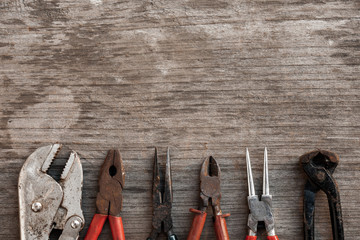 Group of grunge tools on wooden background with empty space for  text or brand.