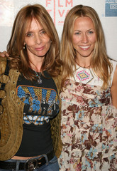 Rosanna Arquette and Sheryl Crow pose for pictures at the Tribeca Film Festival in New York.