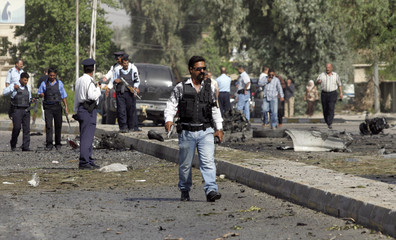 Iraqi police gather at scene of car bomb attack in Baghdad