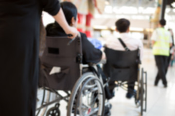 Blurred concept elderly people in wheelchair