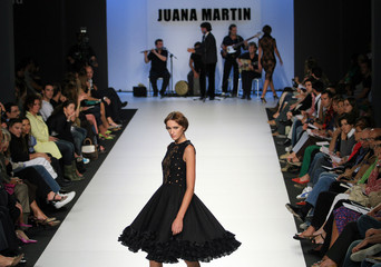 Model displays an outfit by Spanish designer Juana Martin during the Spring/Summer 2006-07 Pasarela Cibeles fashion show in Madrid