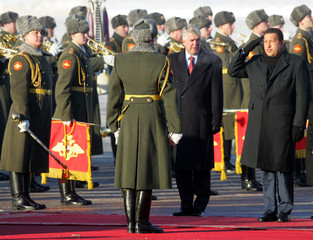 Venezuelan President Hugo Chavez salutes before inspecting honour guard in Moscow's Vnukovo airport.