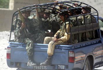 PAKISTANI PARAMILITARY SOLDIERS PATROL THE STREETS OF AZAM WARSAK NEAR WANA.