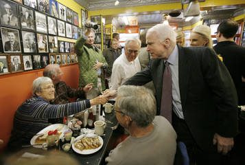 US Republican presidential candidate Senator John McCain greets a diner at Chick and Ruths Delly in Annapolis