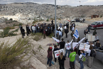 Israeli left-wing activists protest during a cornerstone laying ceremony in Arab East Jerusalem