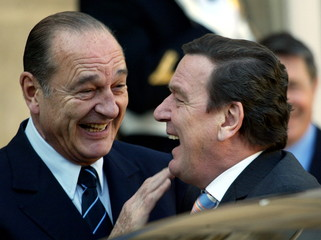 French President Jacques Chirac (L) welcomes German Chancellor Gerhard Schroeder upon his arrival at..