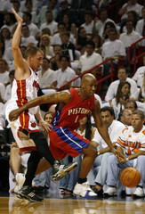 Detroit Pistons' guard Chauncey Billups drives past the Miami Heat's Jason Williams in the first quarter during Game 6 of the NBA Eastern Conference Finals in Miami