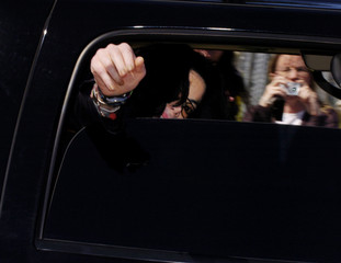 Michael Jackson gestures to fans as he exits the Santa Barbara County Courthouse.