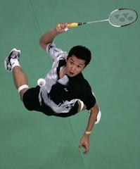 Indonesia's Taufik prepares to smash during World Badminton Championships in Kuala Lumpur