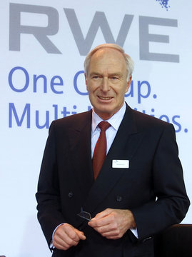 RWE AG CEO Dietmar Kuhnt stands in front of the RWE Group's logo prior to the annual news conference..