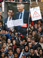 French students hold banner as they demonstrate against the CPE in Marseille